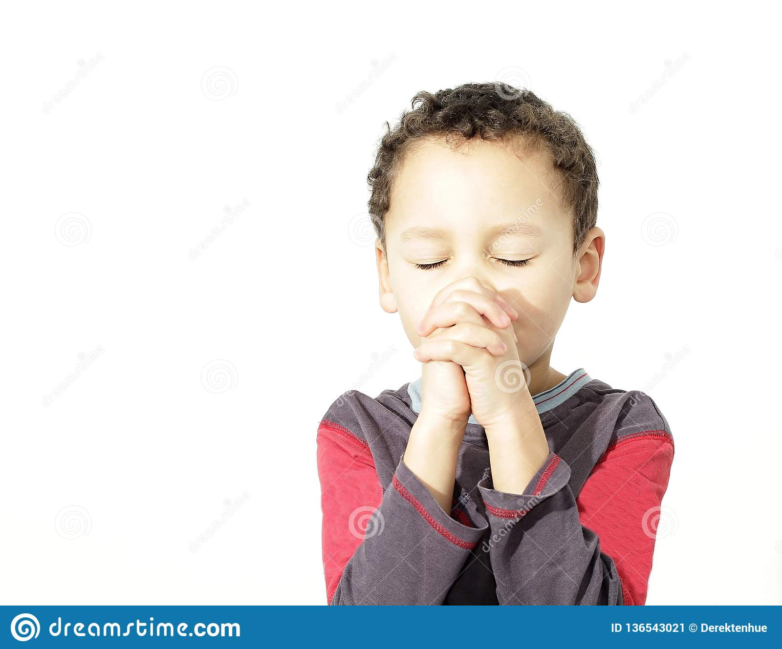 Little boy with hands together praying