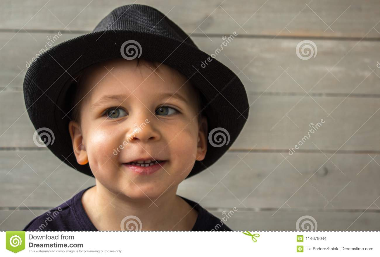 c7be4d5f7bf A Little Boy In A Hat Smiling Stock Photo - Image of portrait
