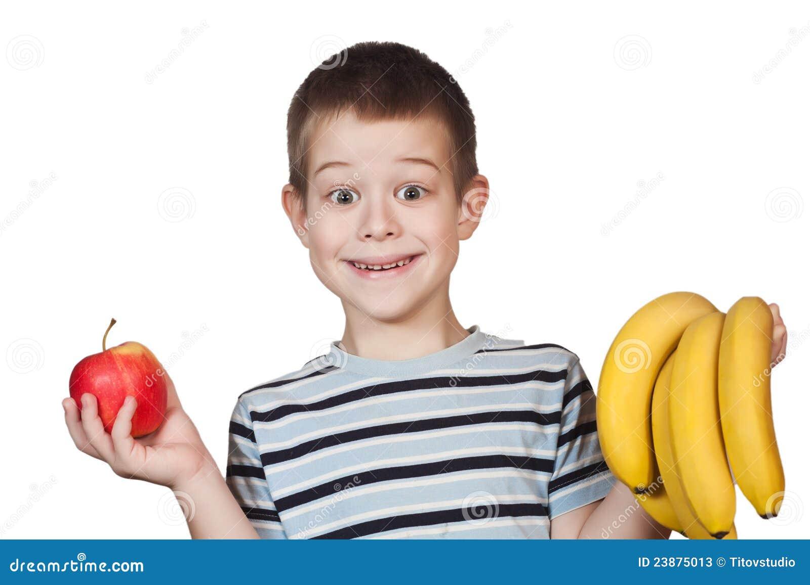 Little Boy holding fruit