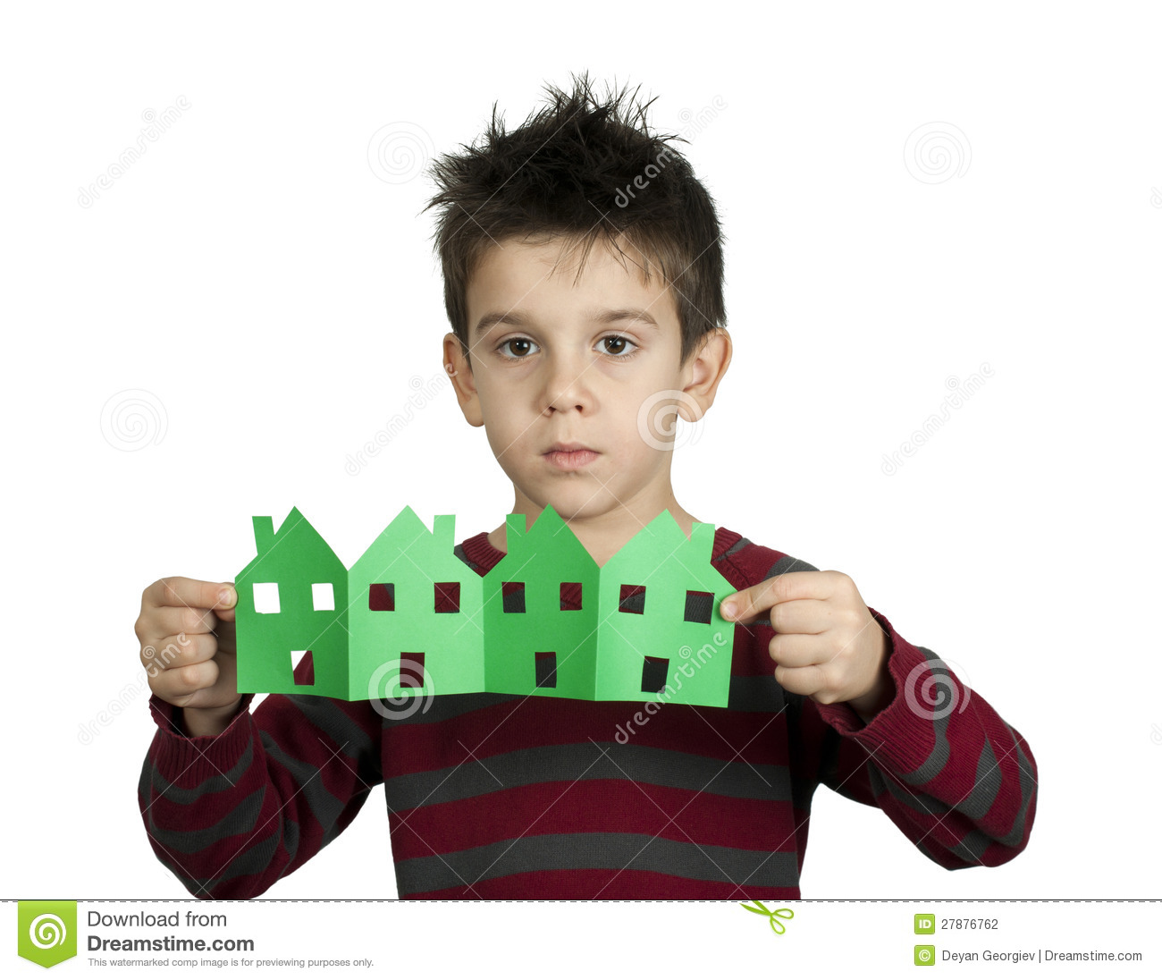 Little boy holding houses made of paper