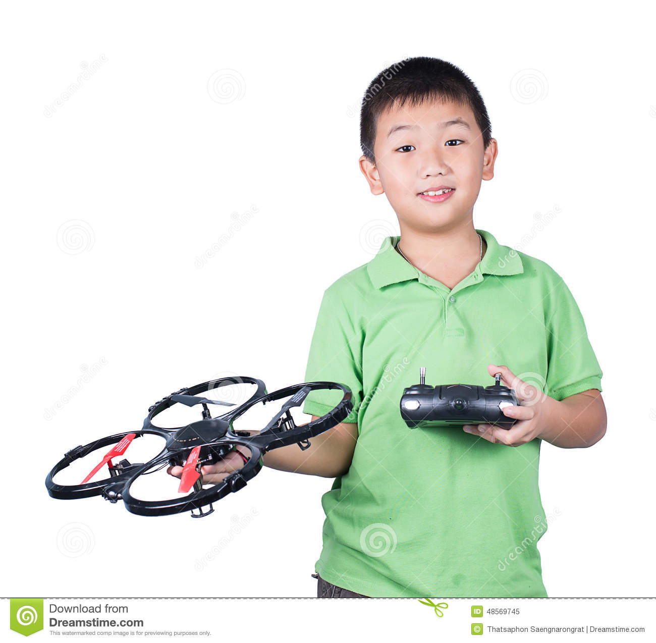 Little boy holding a radio remote control (controlling handset) for helicopter , drone or plane Isolated