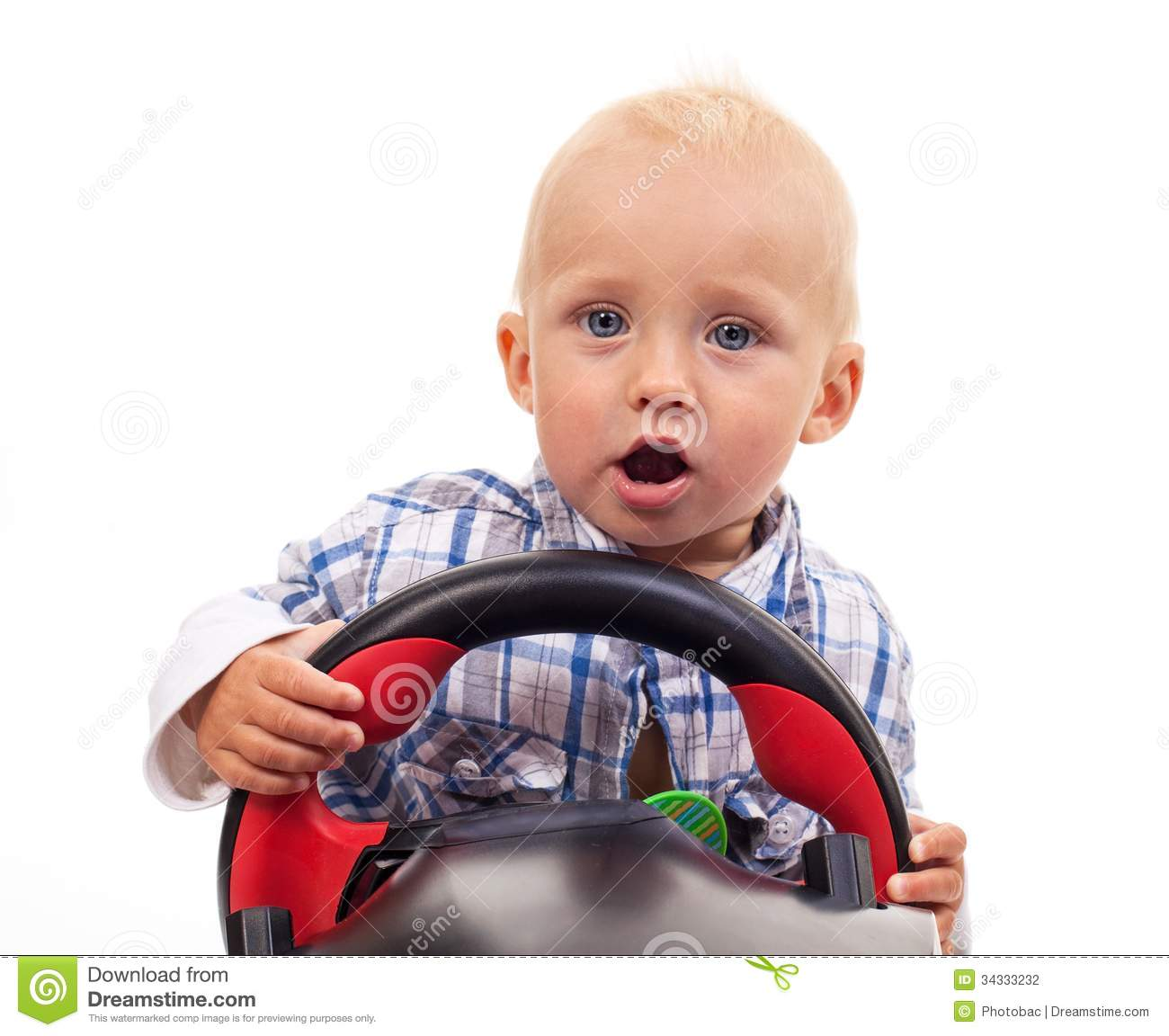 White Boys Toys : Little boy holding a toy steering wheel over white stock