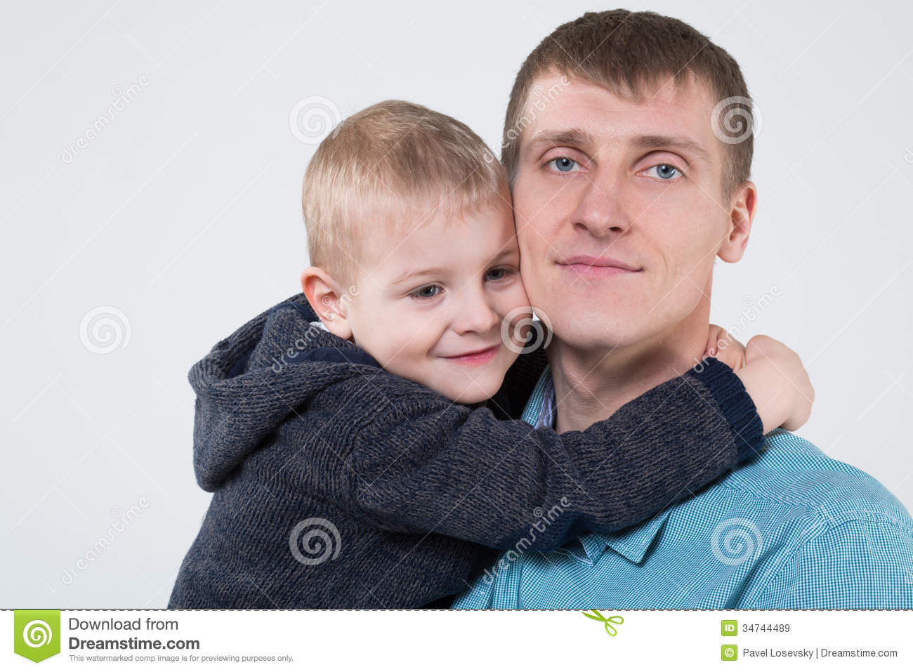 Little boy hugging his father