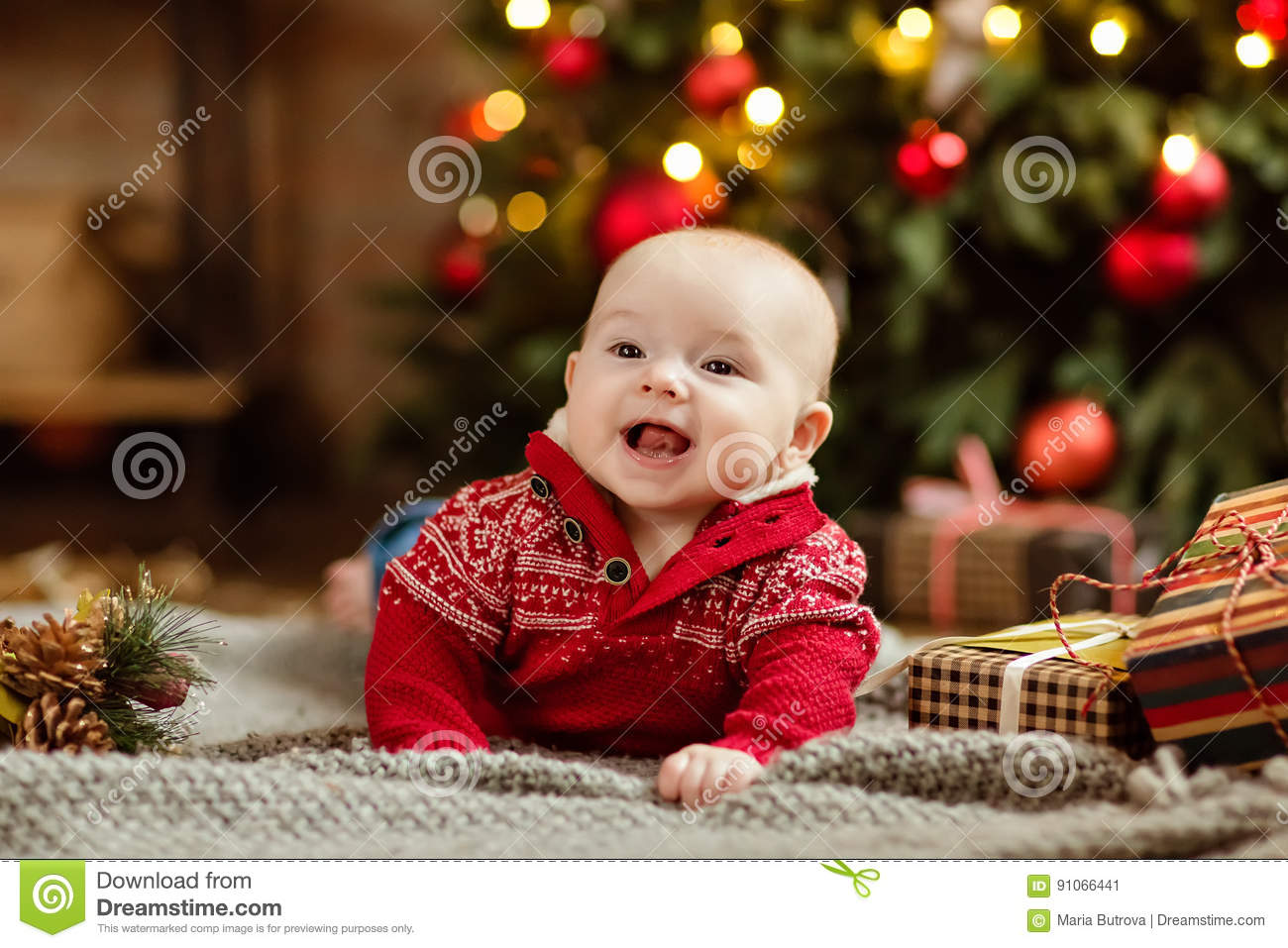 Little Boy The Kid In The Red Sweater Lying On A Cozy Blanket On