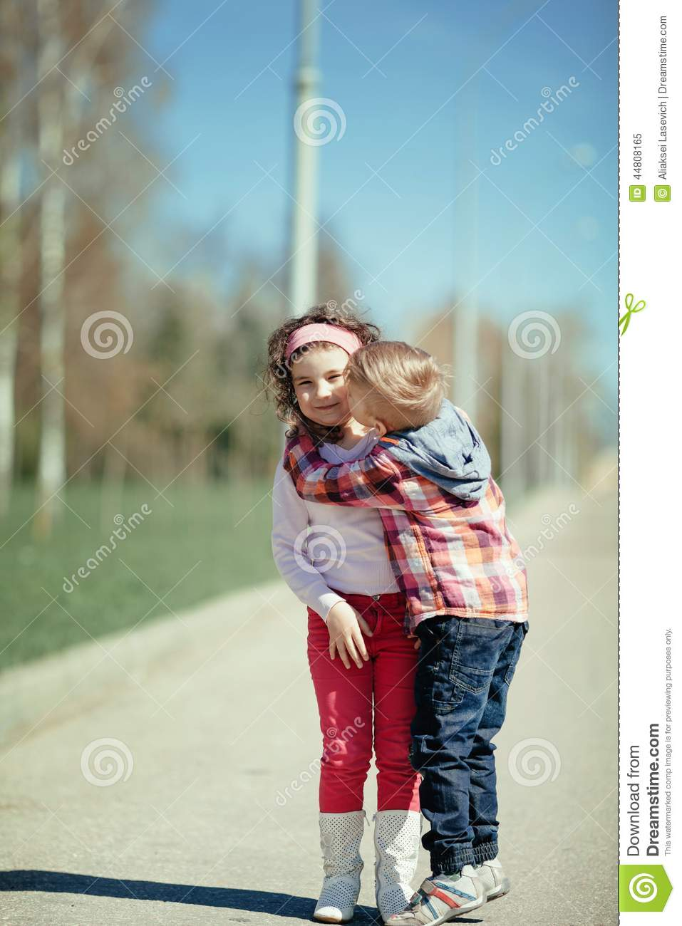 little boy kiss girl on the street stock image - image of little