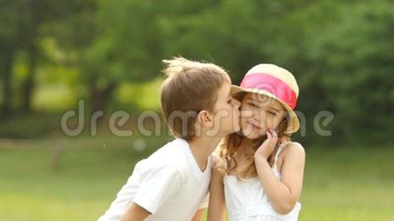 Little boy kisses the girl on the cheek she is embarrassed and little boy kisses the girl on the cheek she is embarrassed and smiles slow motion stock footage video of happy happiness 96082792 altavistaventures Choice Image