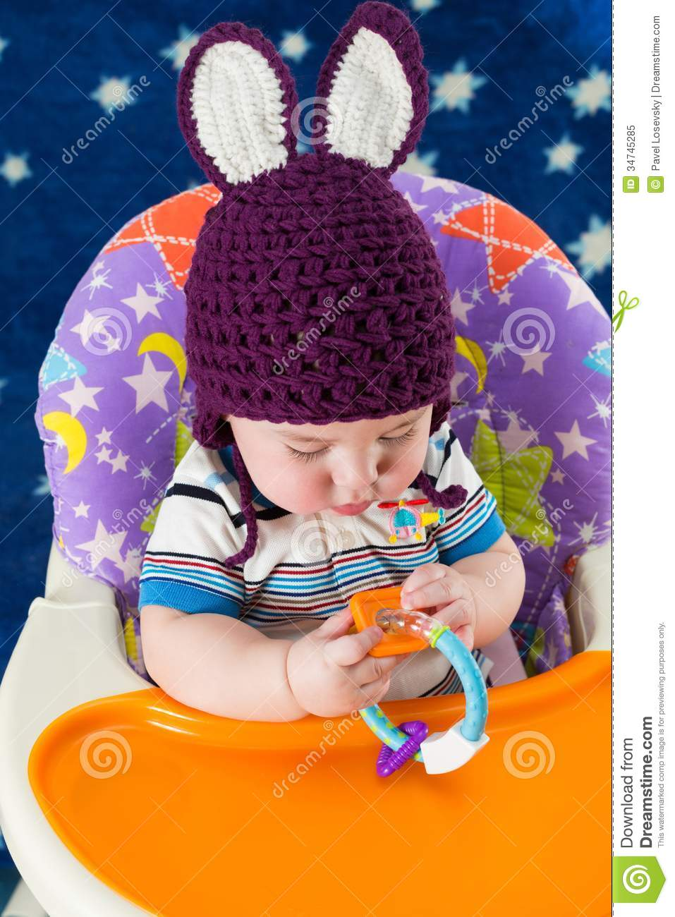 Download A Little Boy In A Knitted Hat With Rabbit Ears Plays Stock Image - Image of knitted, little: 34745285