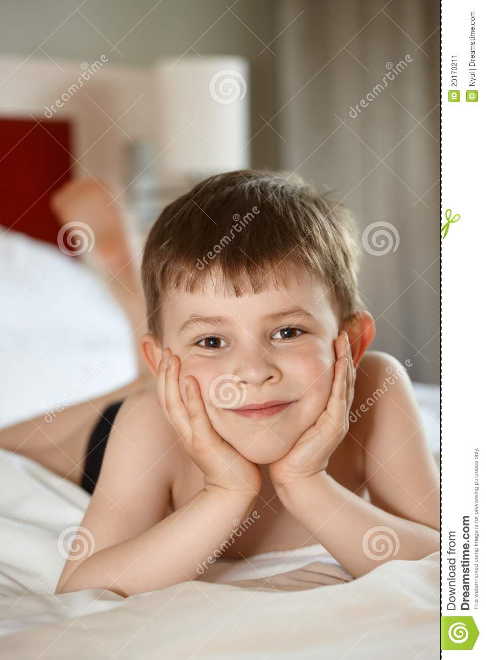 Little Boy Laying On Bed Stock Image Image Of Indoors
