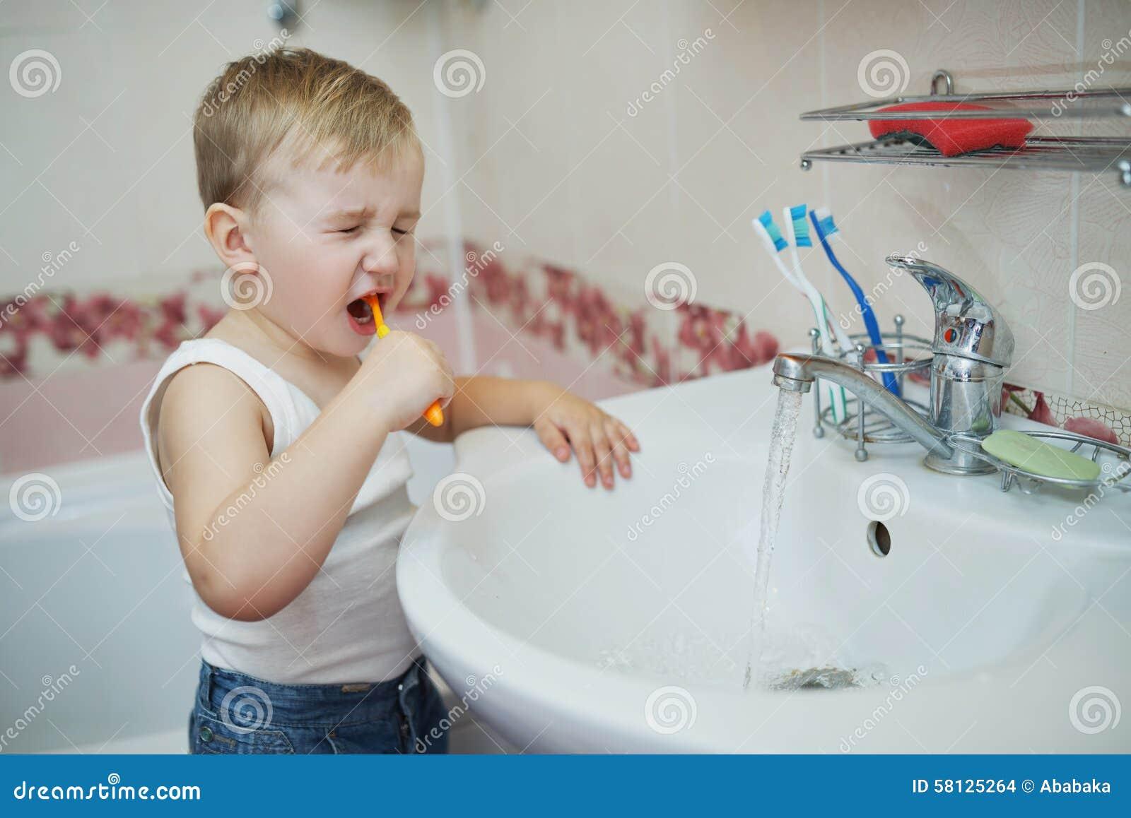 Little boy learns to brush teeth