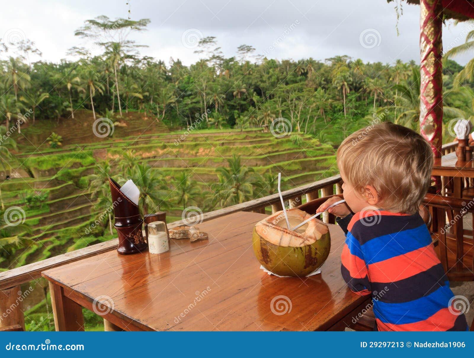 Little boy looking at rice fields