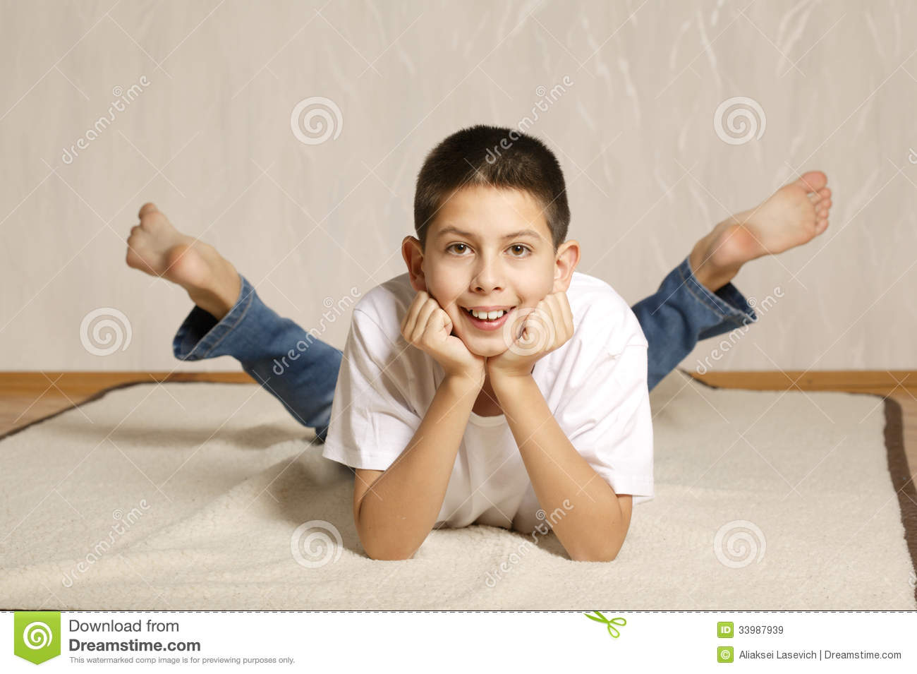Little Boy Lying On Floor Royalty Free Stock Images