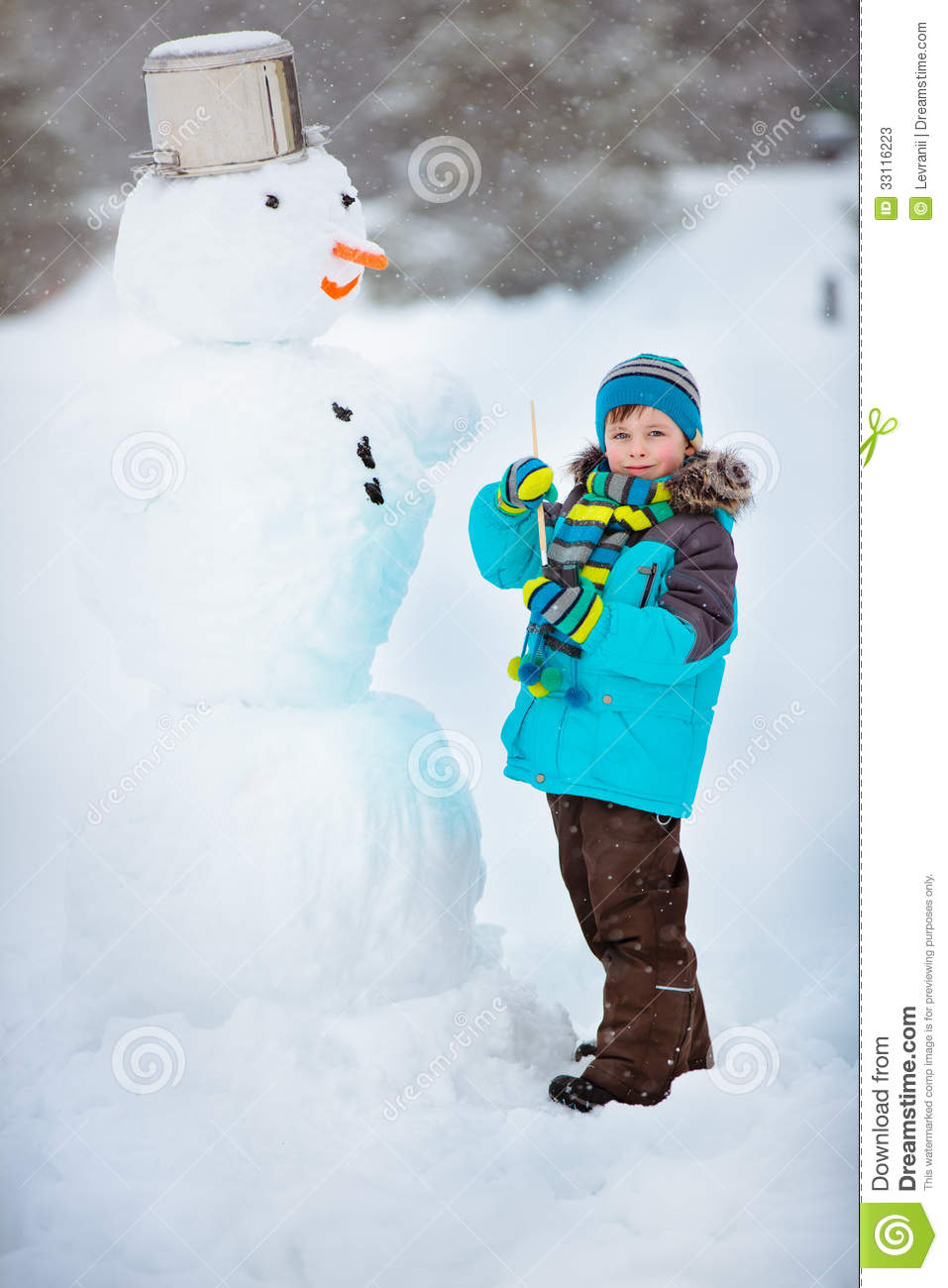 Little boy making a snowman stock image image of outside for I want to make a snowman