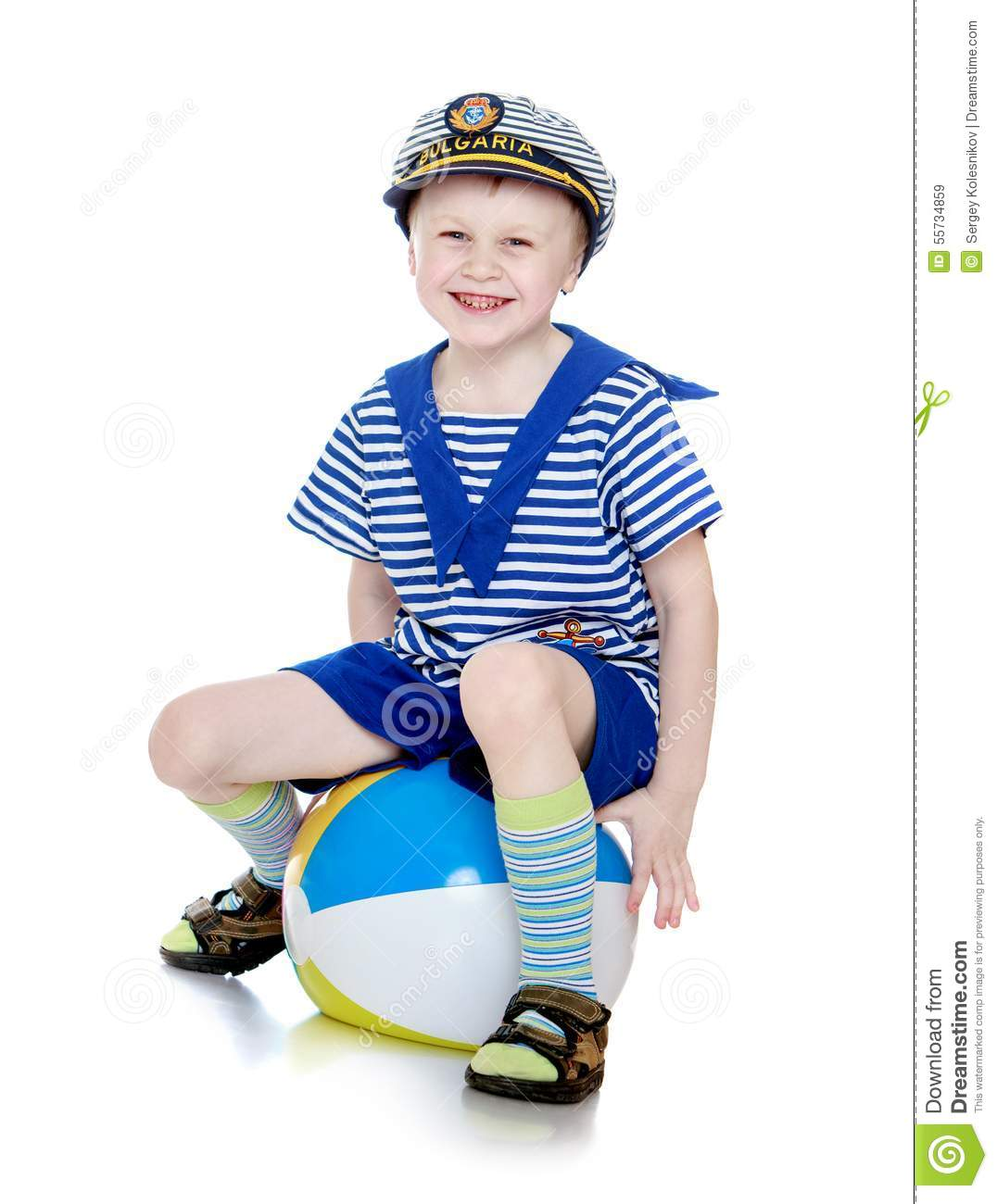 Little boy in a marine suit sitting on the ball