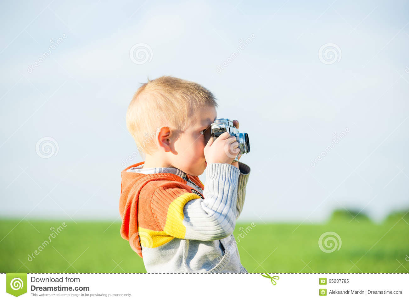 Download Little Boy With An Old Camera Shooting Outdoor Stock Image