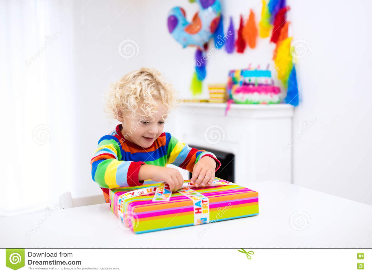 Child Celebrating Third Birthday Little Boy Opening Presents And Holding Balloons In Decorated Room Party For Kids