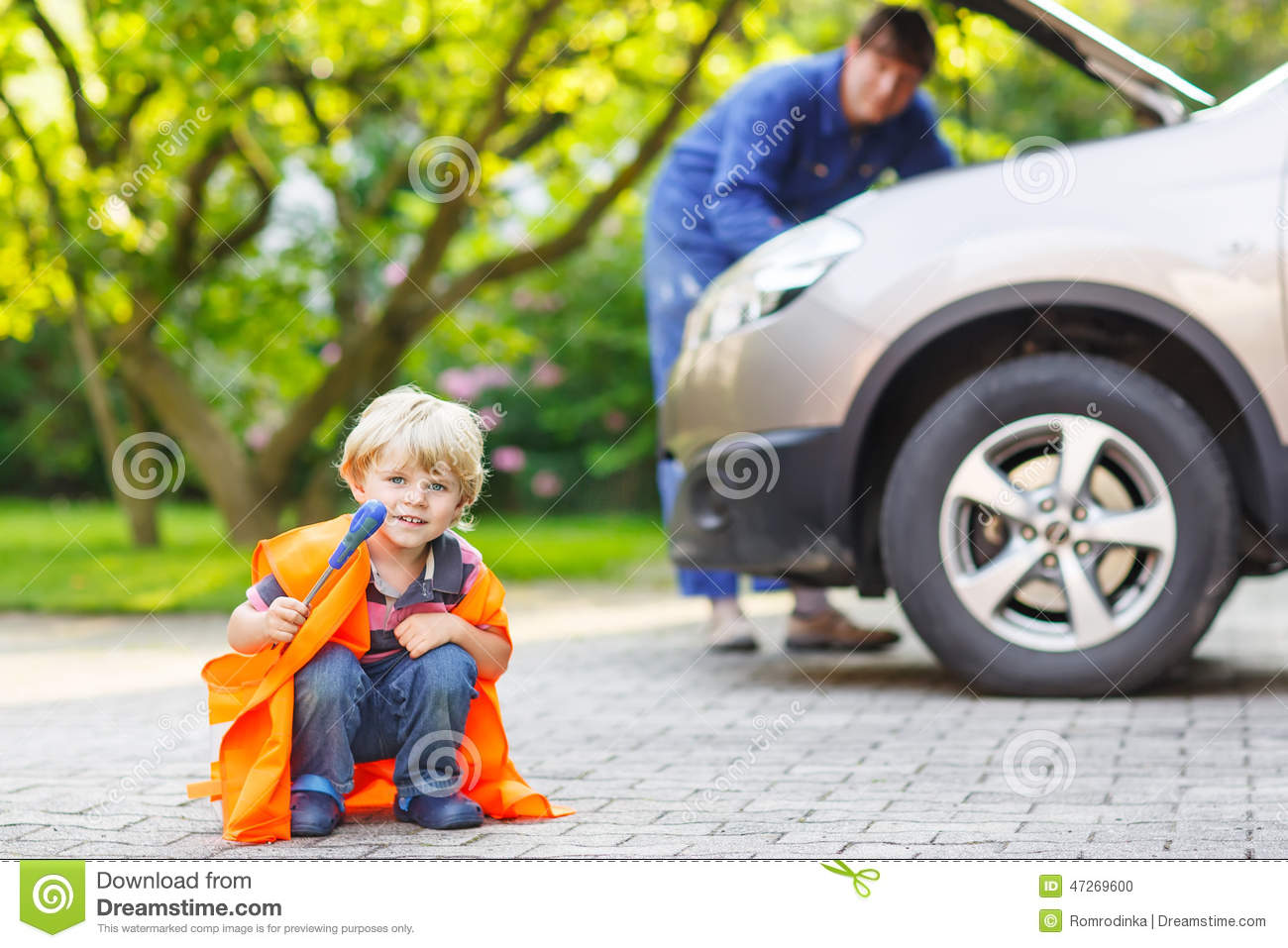 little boy in orange safety vest during his father repairing fam stock photo image 47269600. Black Bedroom Furniture Sets. Home Design Ideas