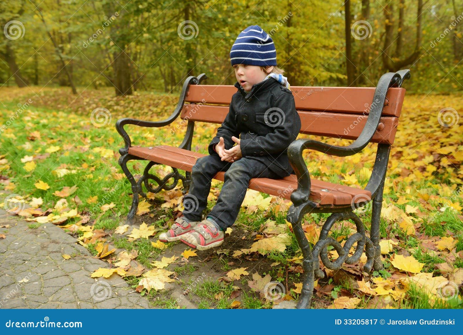 Little boy in the park in autumn