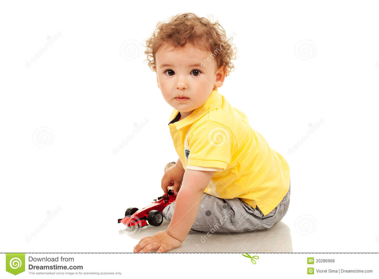 Little Boy With Toy Car : Little boy plaing with toys near the fire place royalty