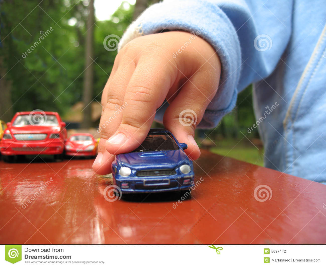 Hunting Toys For Little Boys : Little boy play with toy car stock photography image