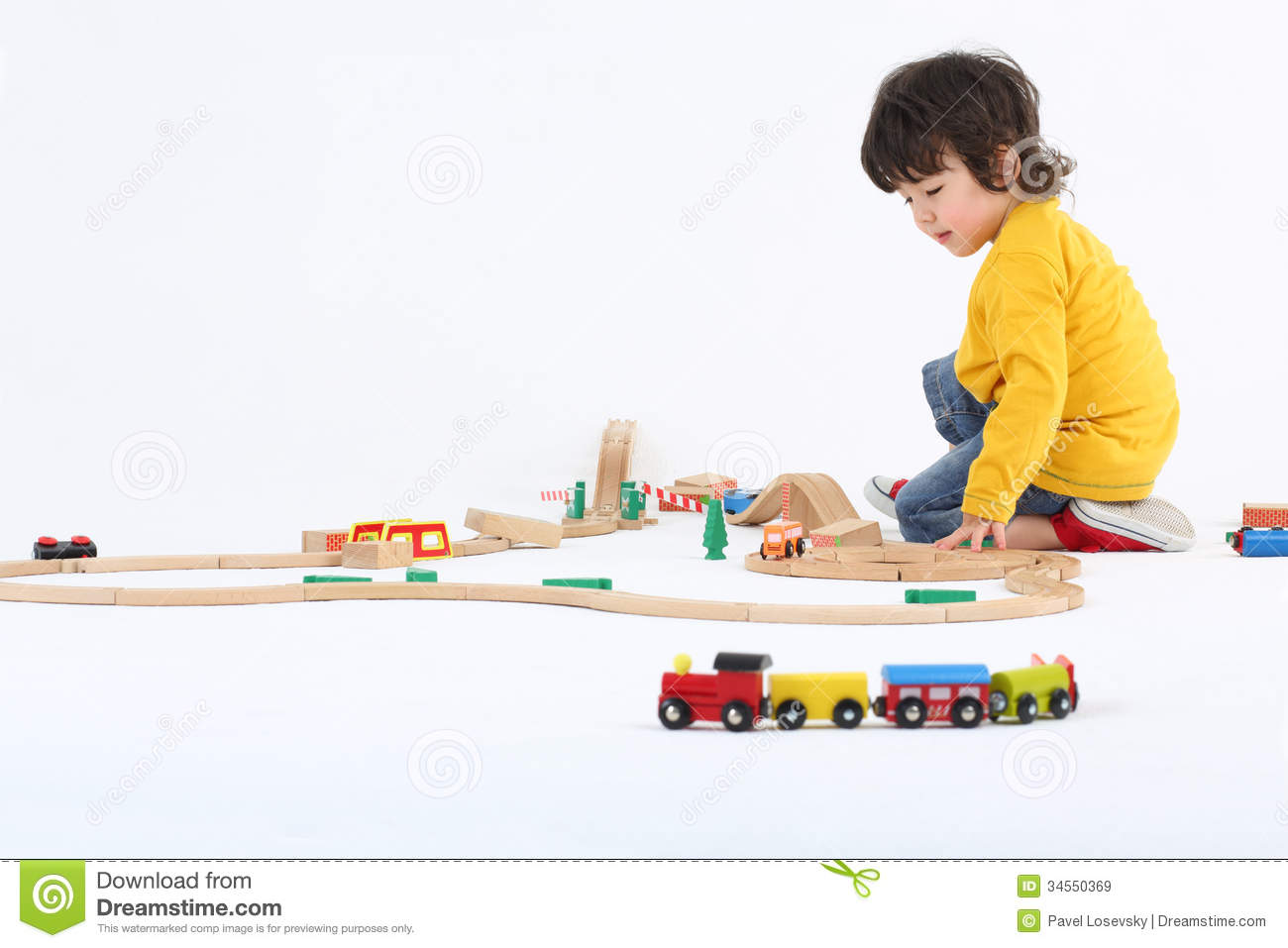 Little Boy Play With Toy Trains And Big Wooden Railway Royalty Free Stock Images - Image: 34550369