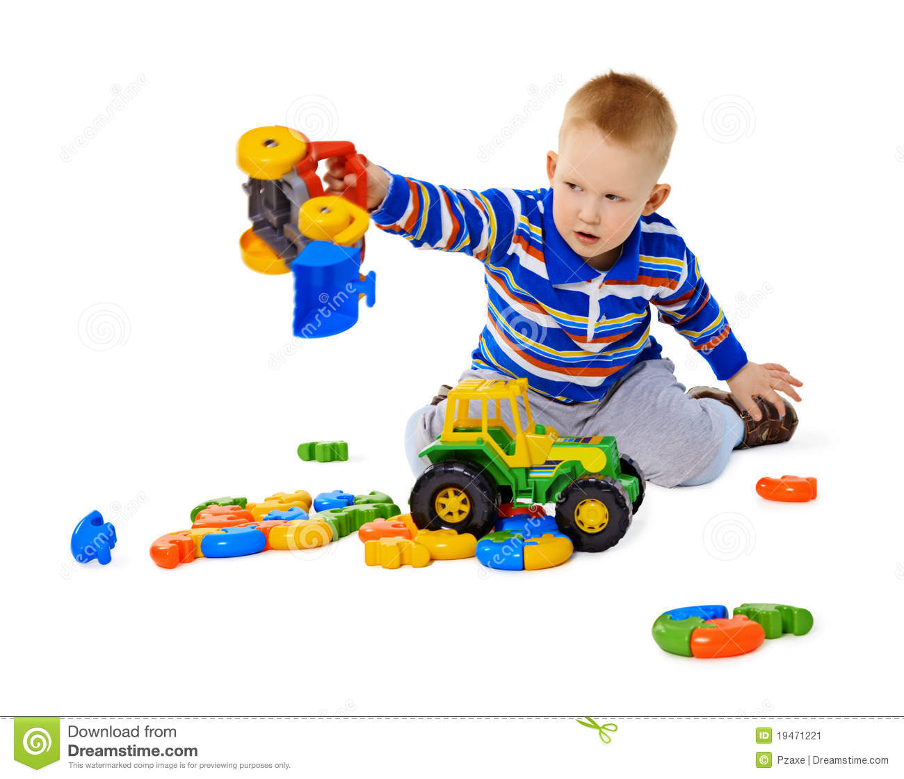 Little Boy Toys : Little boy playing actively with plastic toys stock image