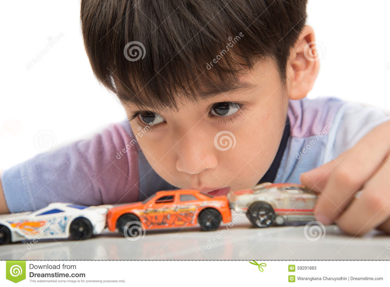 Little Boy With Toy Car : Little boy playing with toy cars royalty free stock photo