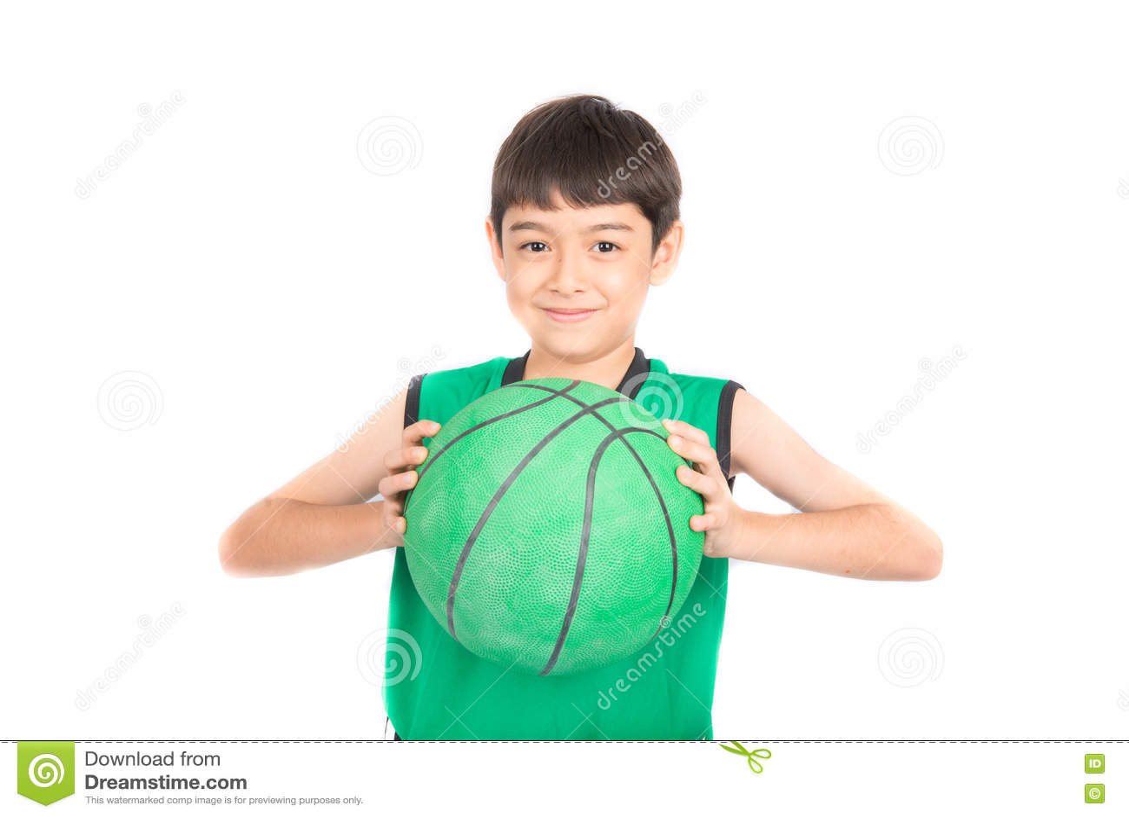 Little boy playing green basketball in green PE uniform sport