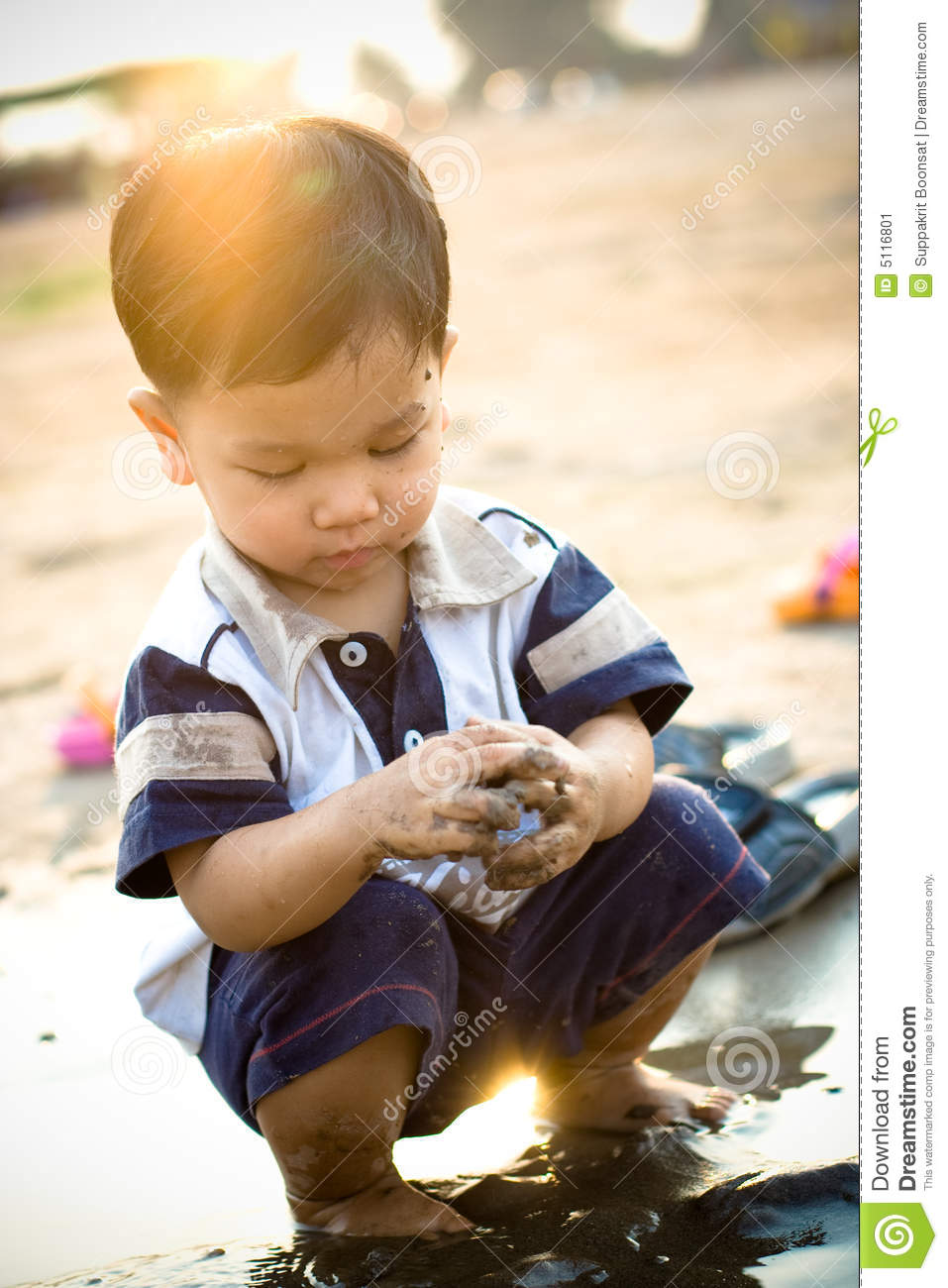 Boy Working And Playing In The Mud Stock Photo - Image of