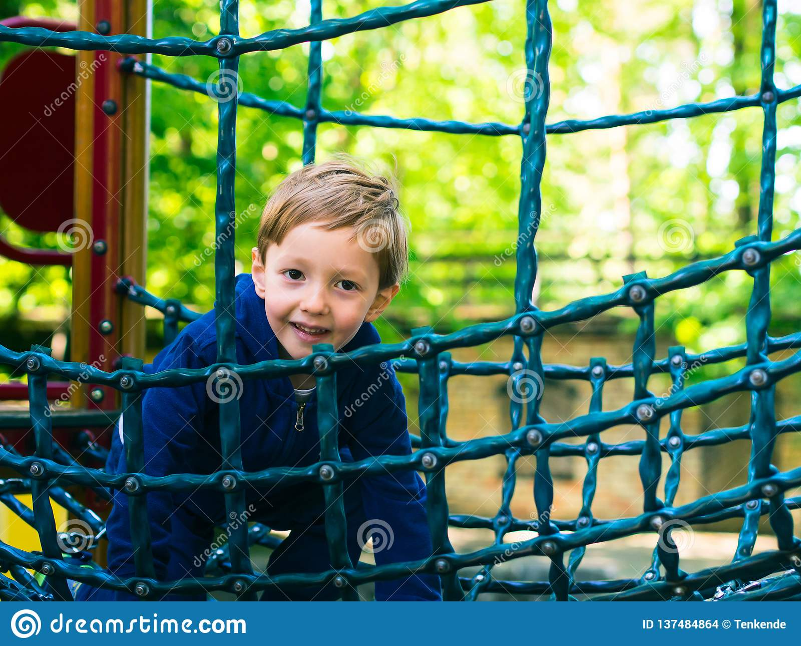 Little boy playing on a playground. Activity