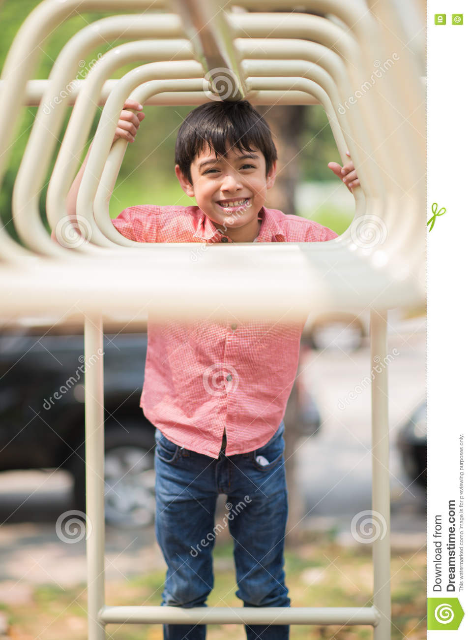 Little boy playing at playground climbing