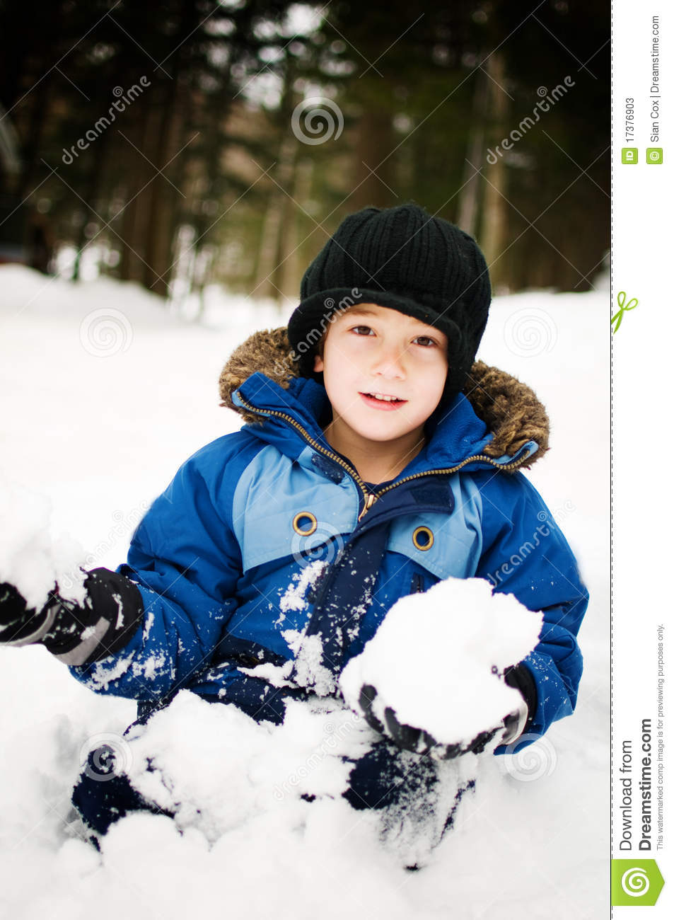 little boy playing in the snow stock photos image 17376903
