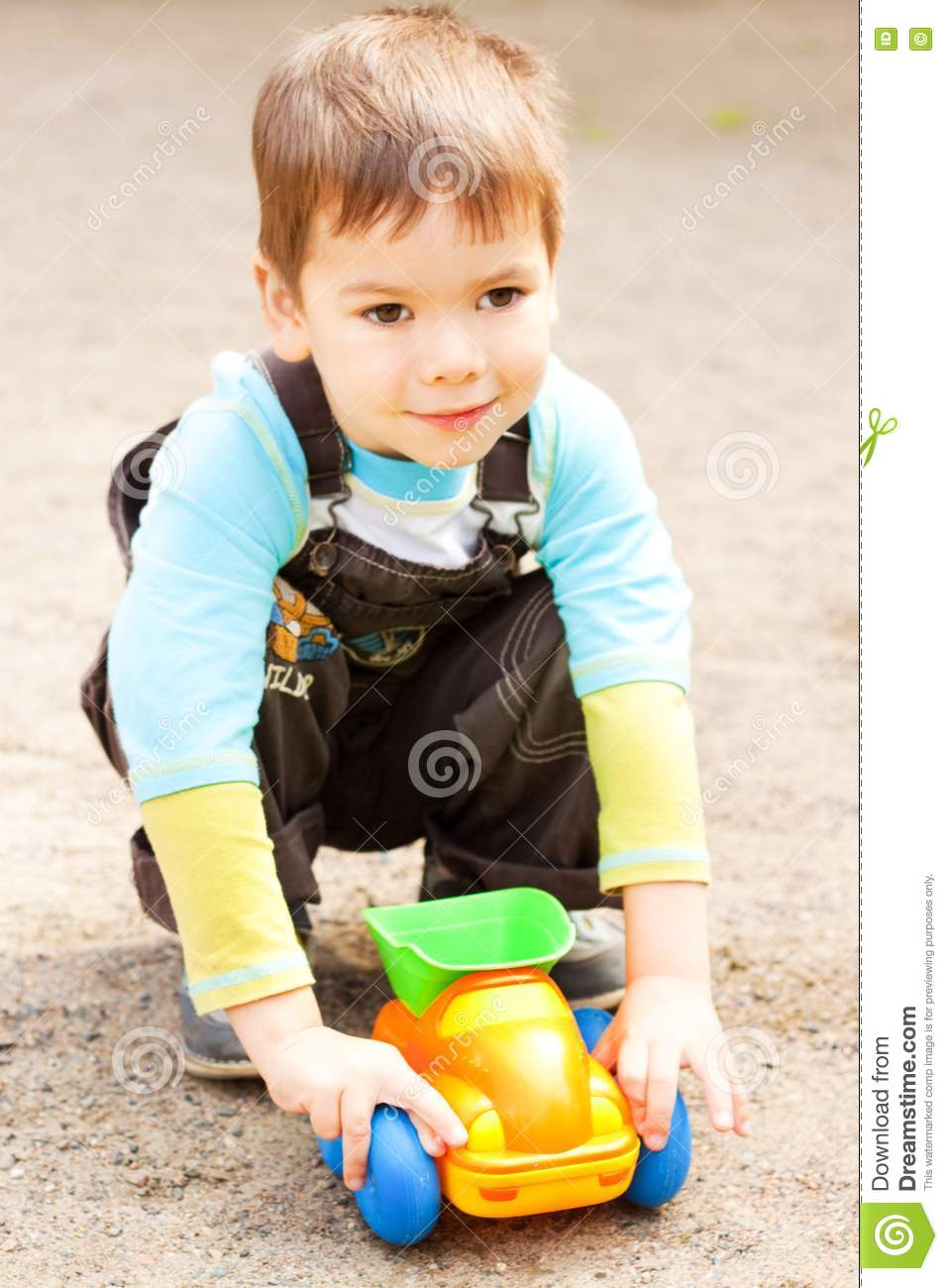 Little Boy With Toy Car : Little boy playing in the toy car stock image
