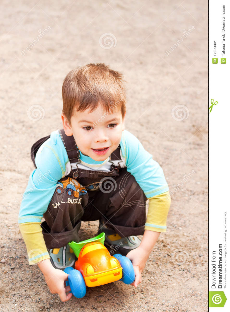 Little Boy With Toy Car : Little boy playing with a toy car stock image