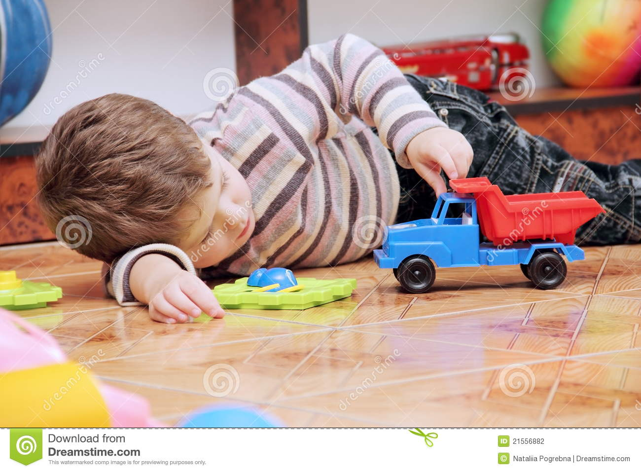 Little Boy With Toy Car : Little boy playing with toy car stock photography image