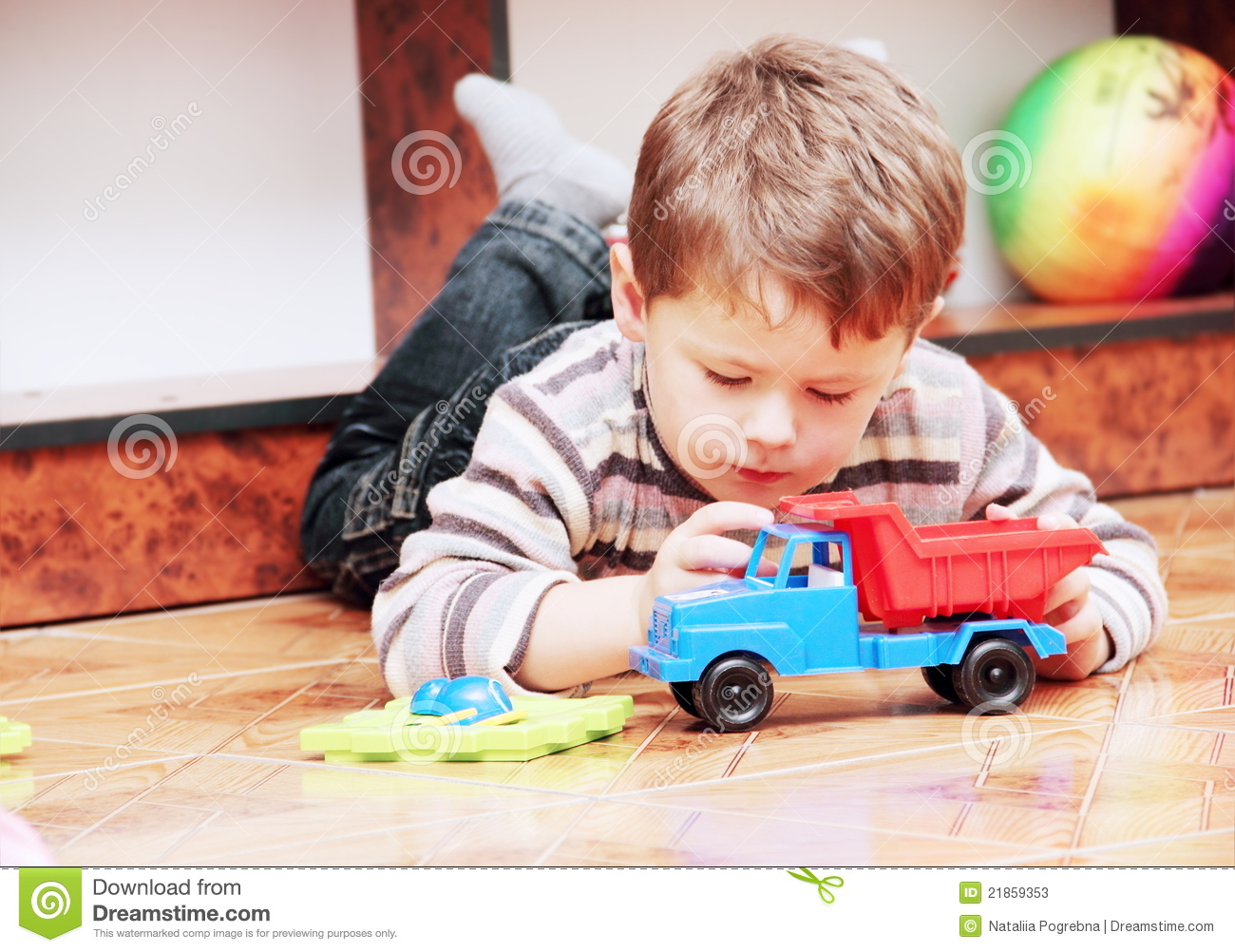 Little Boy With Toy Car : Little boy playing with toy car stock photos image