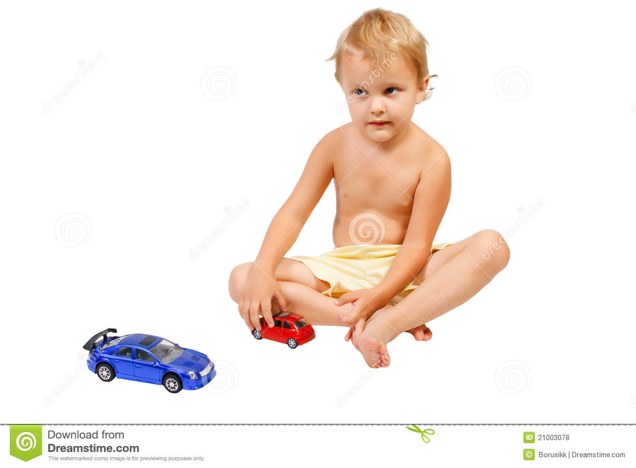 Little Boy Toys : Little boy playing with toy cars royalty free stock photos