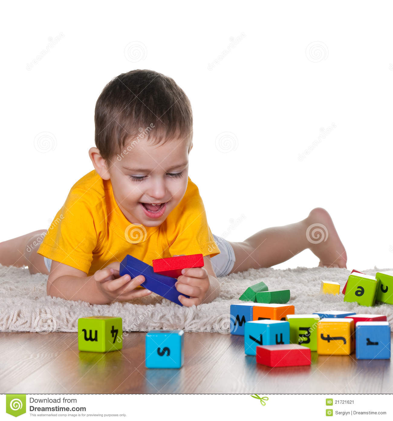 Little Boy Toys : Little boy playing toys on the carpet stock image