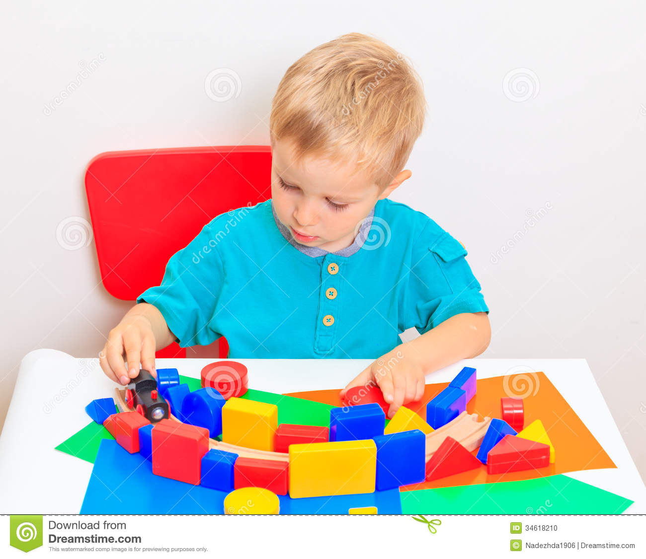 Little Boy Toys : Little boy playing with toys stock photo image