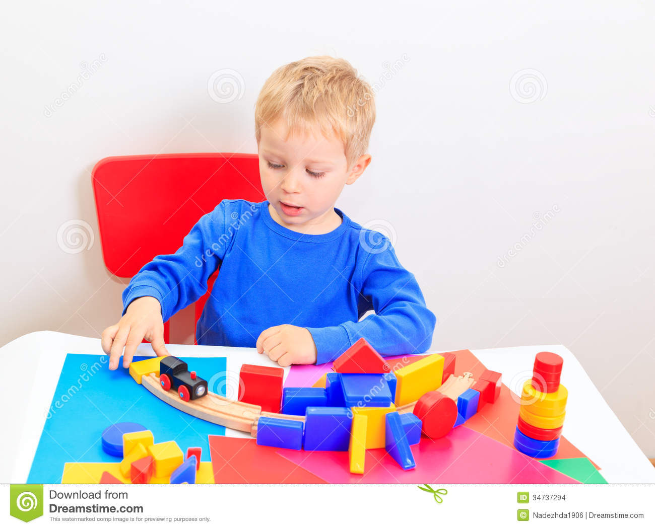 Little Boy Toys : Little boy playing with toys stock images image