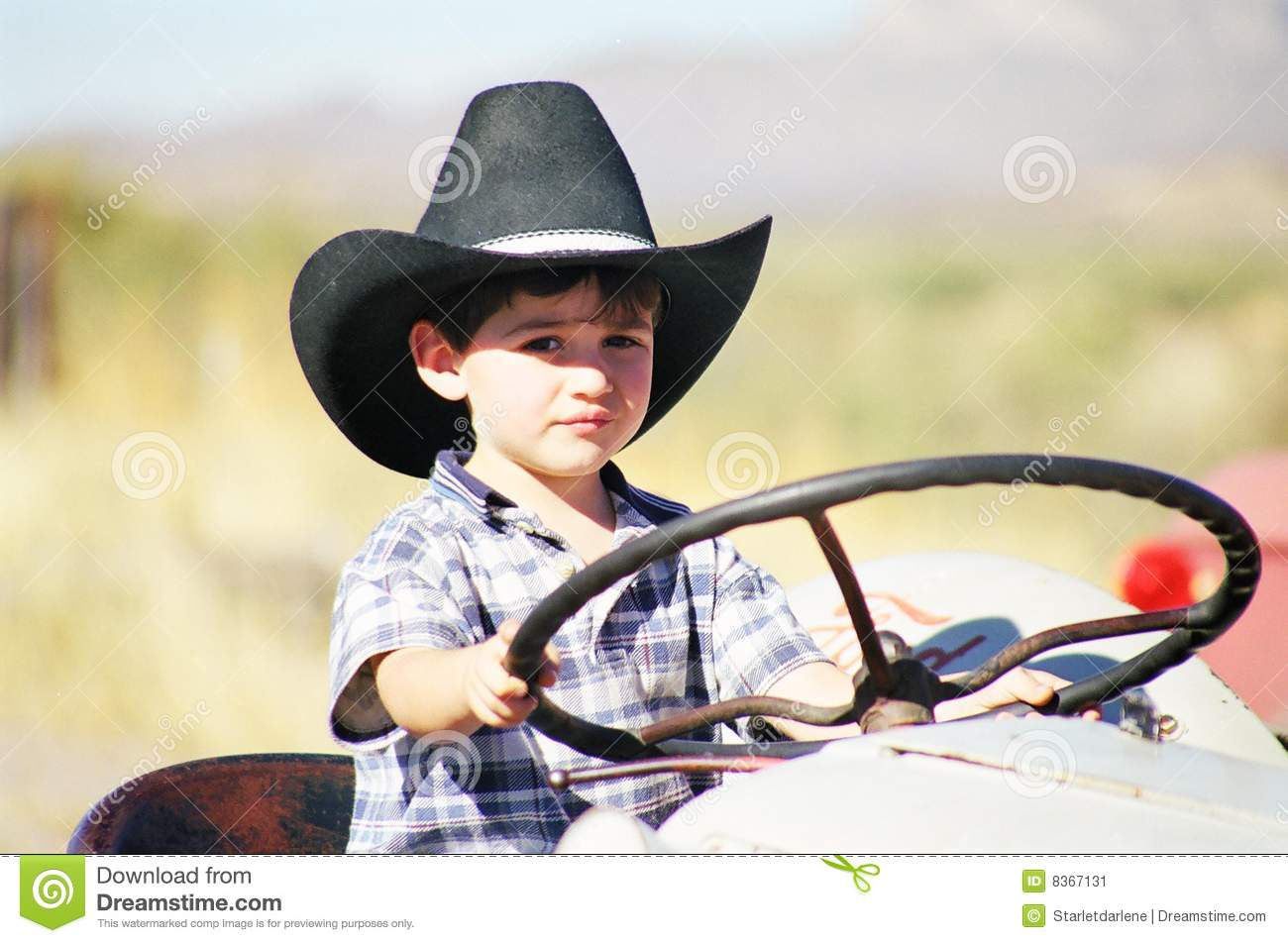 Boy On Tractor : Little boy playing on tractor stock image