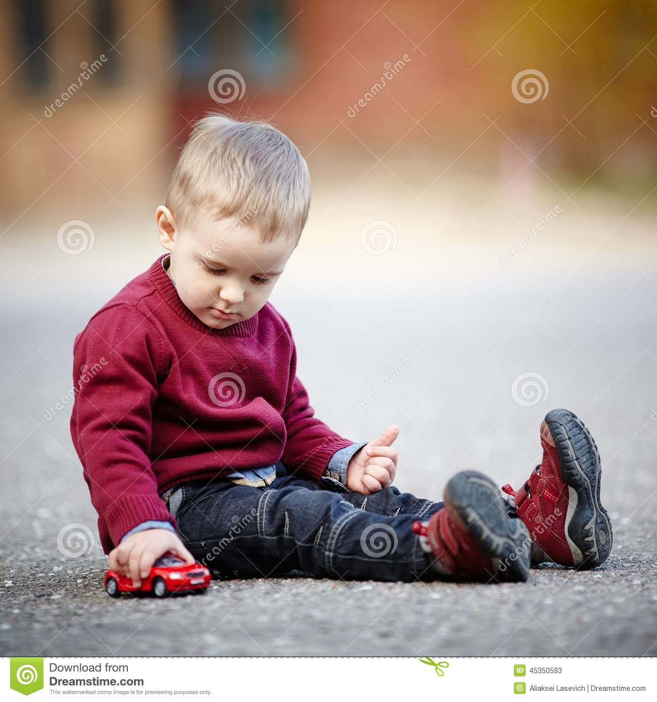 Little Boy With Toy Car : Little boy plays with toy car stock image of