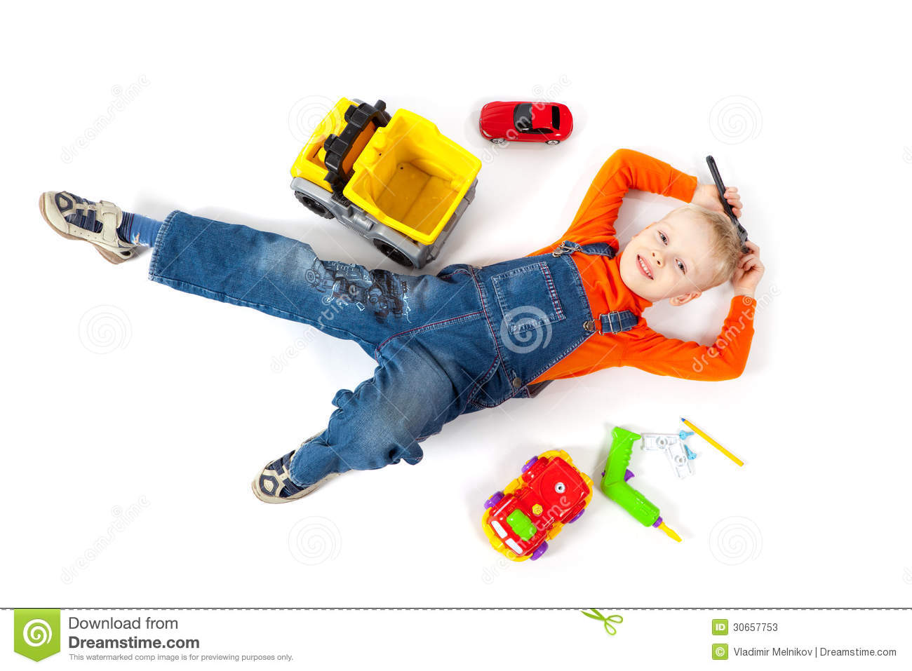 Boy Toys Background : Little boy repairs his toy car stock photos image