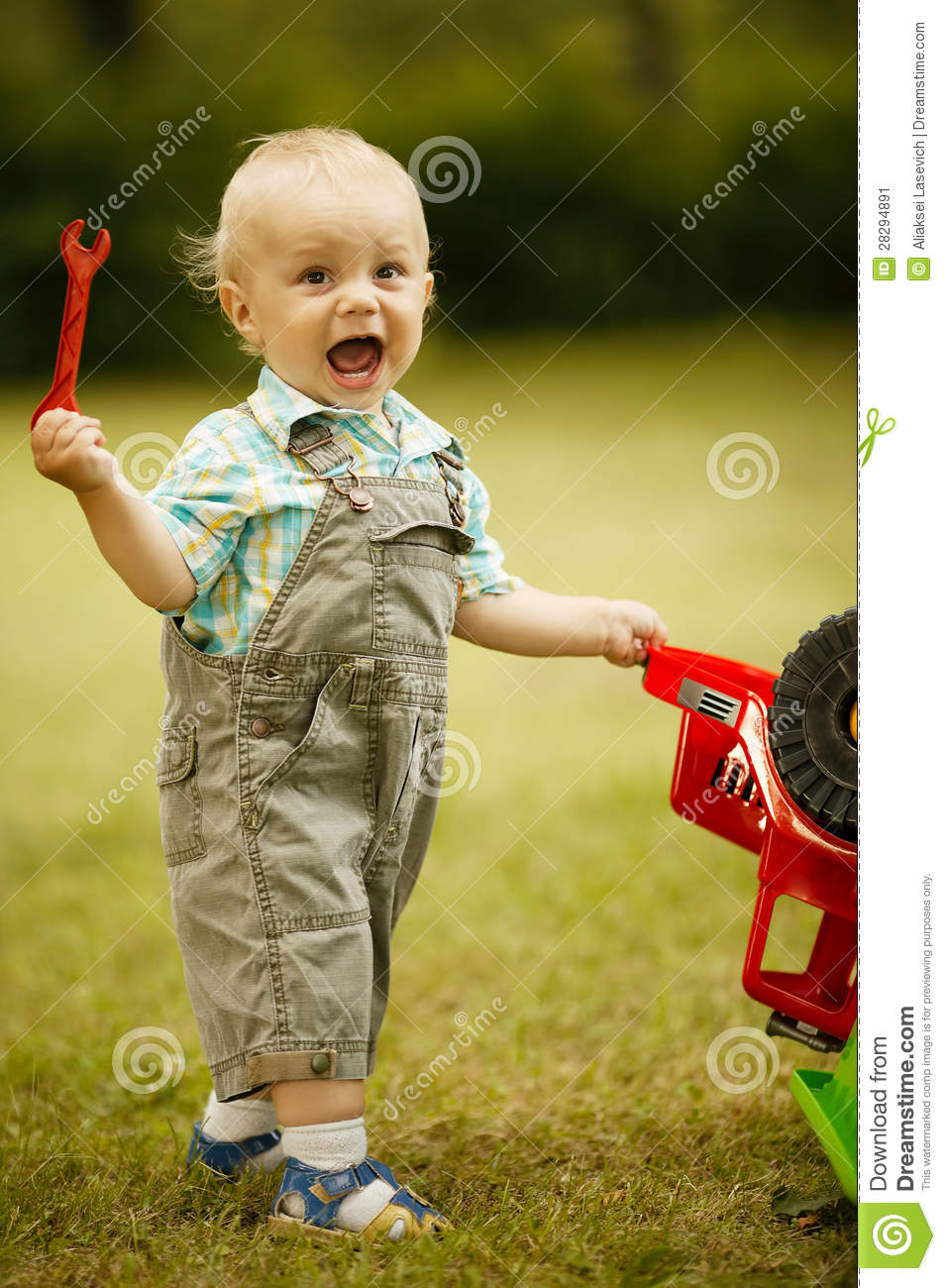 Little Boy With Toy Car : Little boy repairs toy car stock image