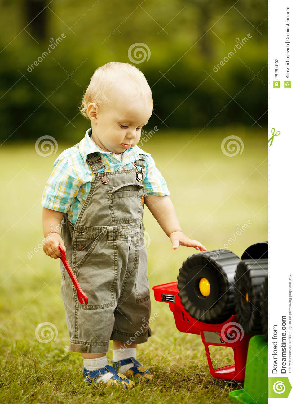 Little Boy With Toy Car : Little boy repairs toy car stock photo image of portrait