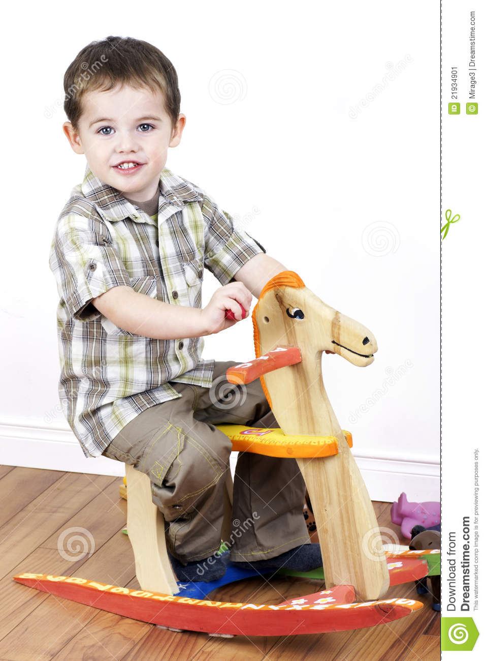 ... riding a handcarfted wooden rocking horse chair, vertical studio shot