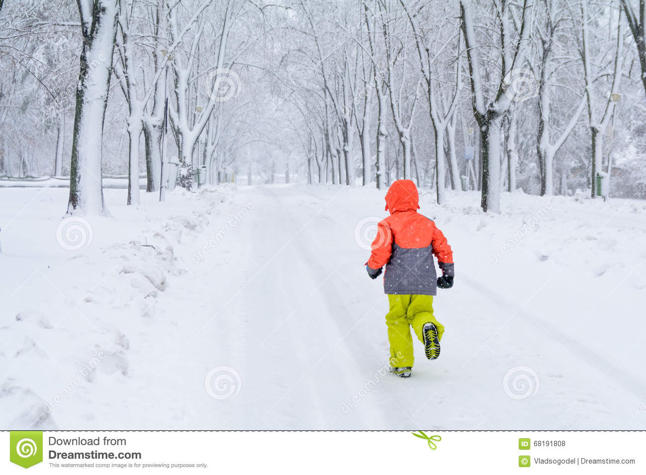 81bf23274412 Little Boy Running On Snow. Kid Boy Running Along The Road With ...