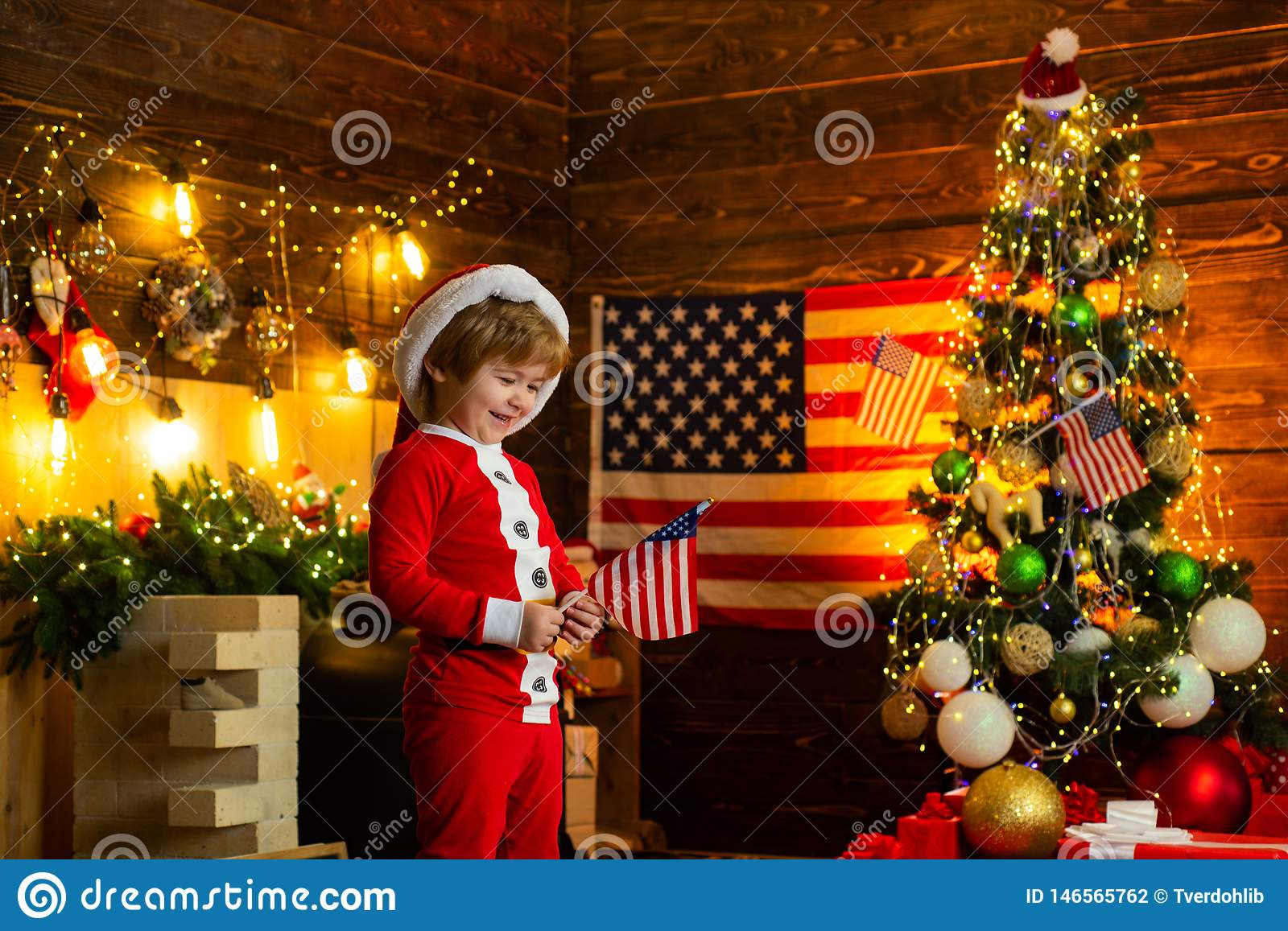 Little boy santa hat and costume having fun. American traditions concept. Toddler celebrate christmas. True american