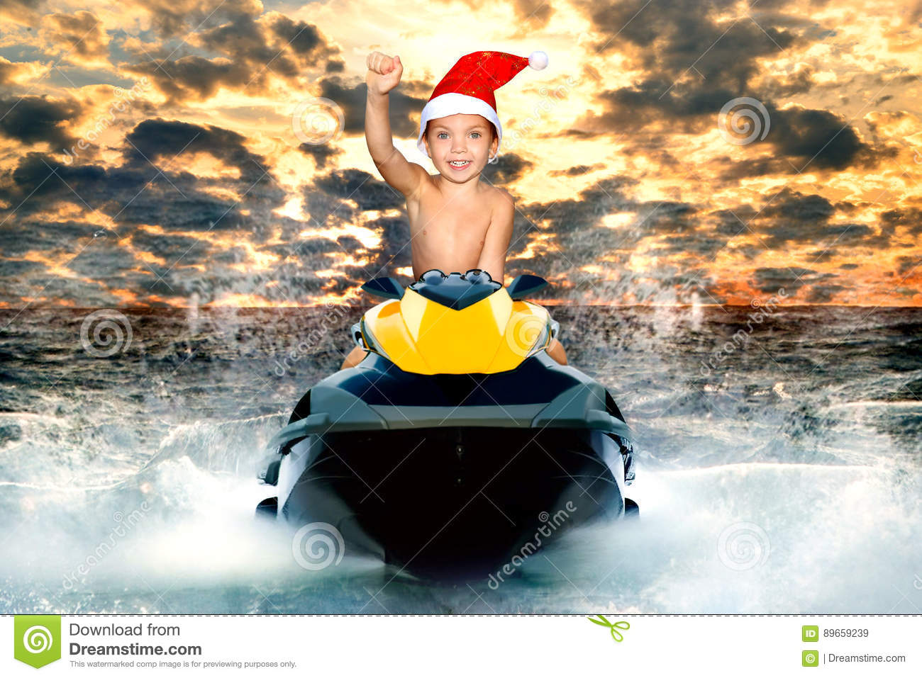 28696e12759fb Little Boy In Santa Hat Riding A Water Scooter On The Waves. Stock ...