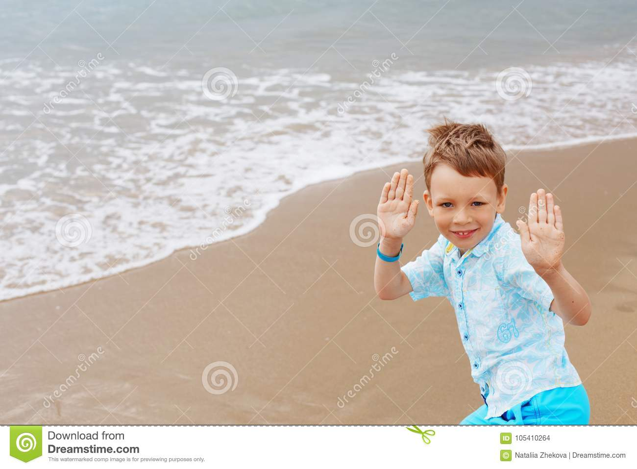 6959aeb85 Little boy in hat, shirt and shorts on the beach sand. Little boy having  fun on tropical ocean beach. Kid during family sea vacation. Summer water  fun.