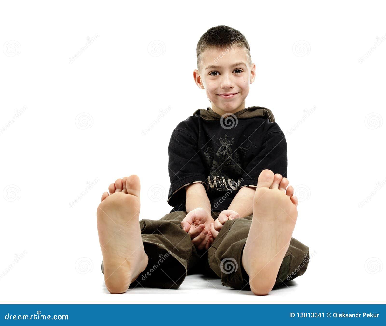 Little Boy Sitting Barefoot, Stock Image - Image: 13013341
